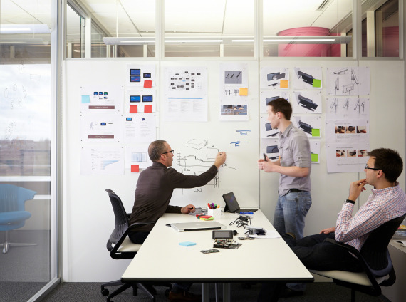 People working in a highly collaborative innovation work place