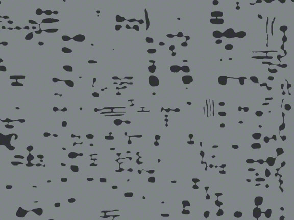 A gray and black speckled rug from ARZU