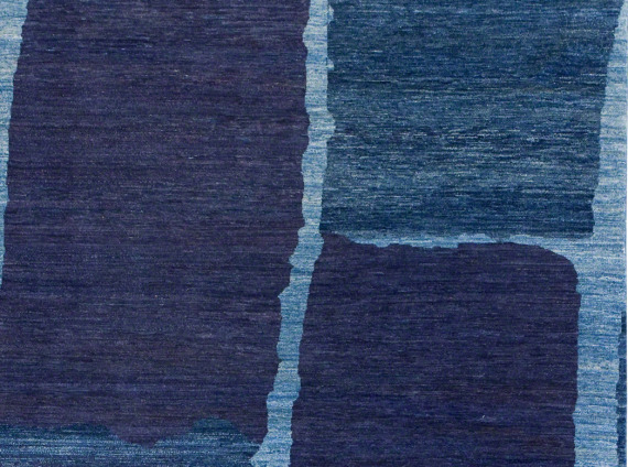 Blue floor rug with a stone pattern by ARZU
