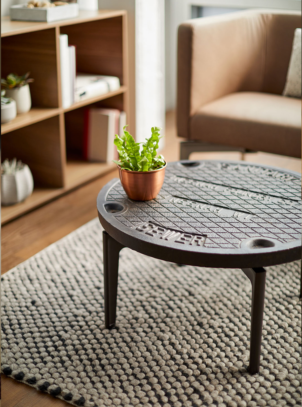 Bassline table with manhole top by turnstone
