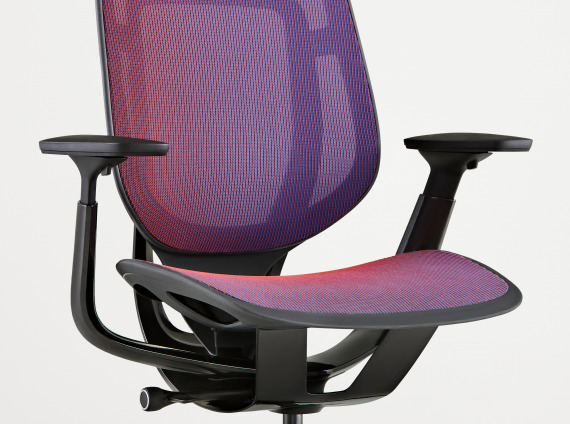 angled view of a Steelcase Karman chair with purple mesh