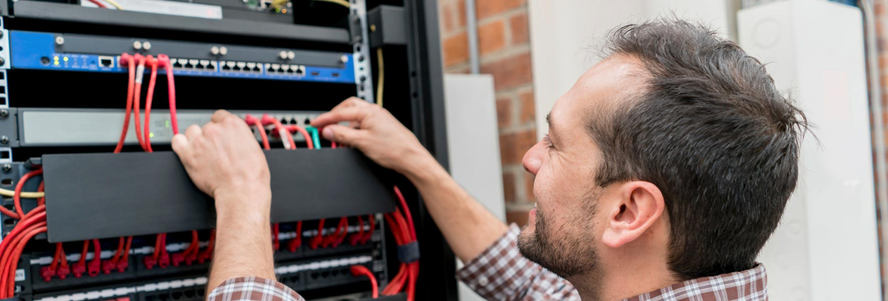 man working on cabling system
