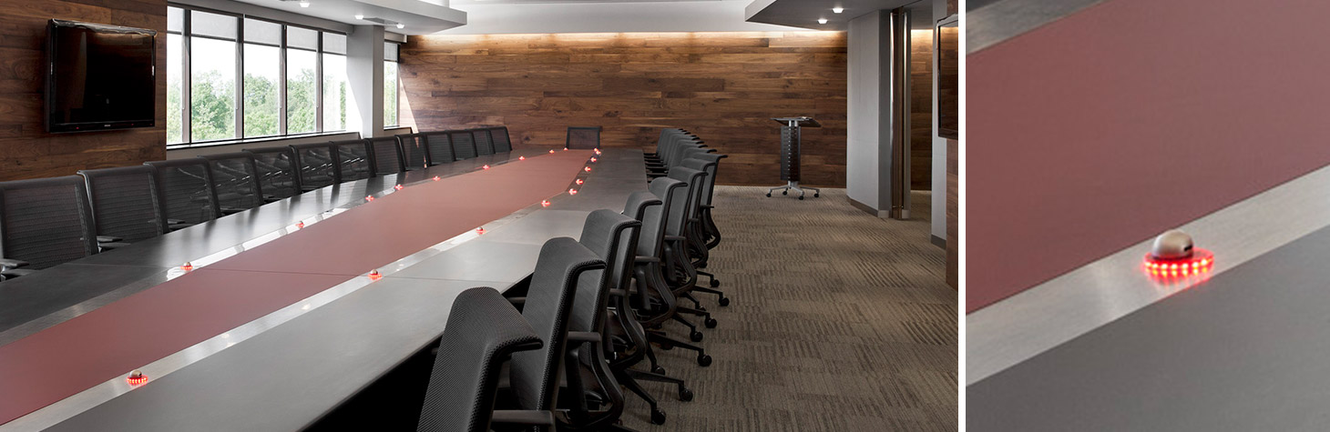 custom conference table with embedded microphones and LED lighting