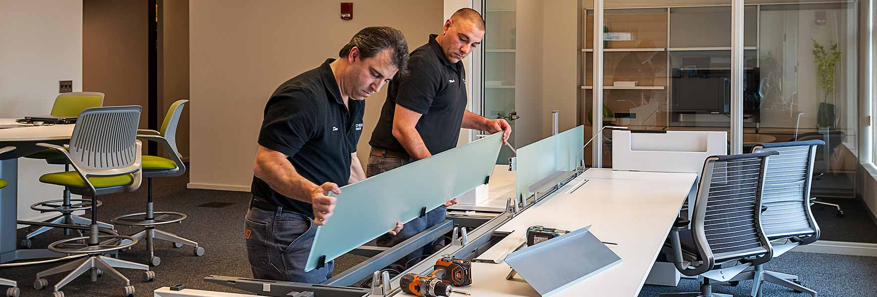 Office movers installing a workstation during move services